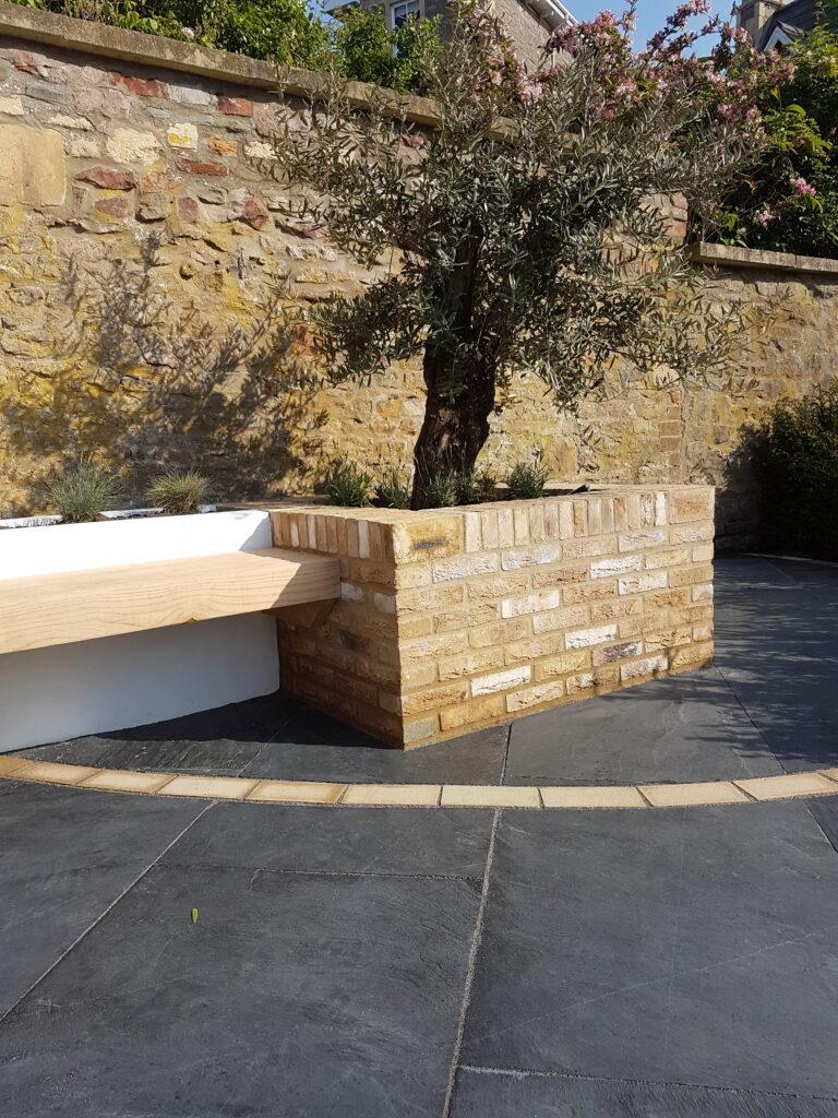 Facing bricks bring a classic feel to garden schemes.