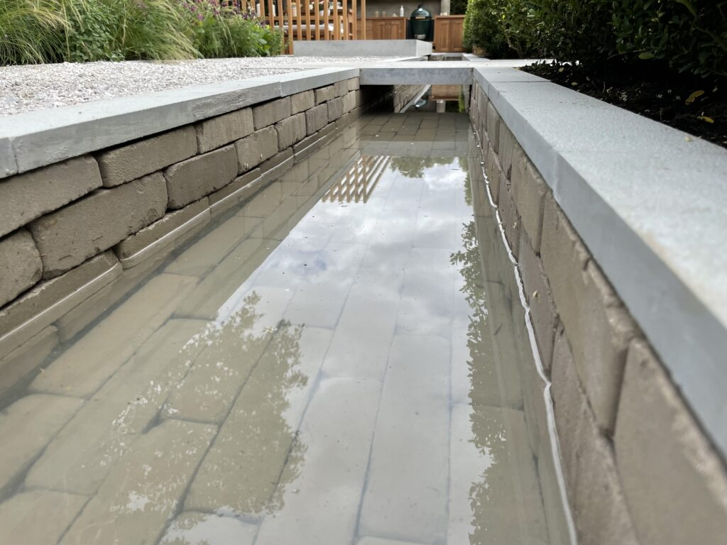The clay pavers look impressive submerged as part of this water feature.
