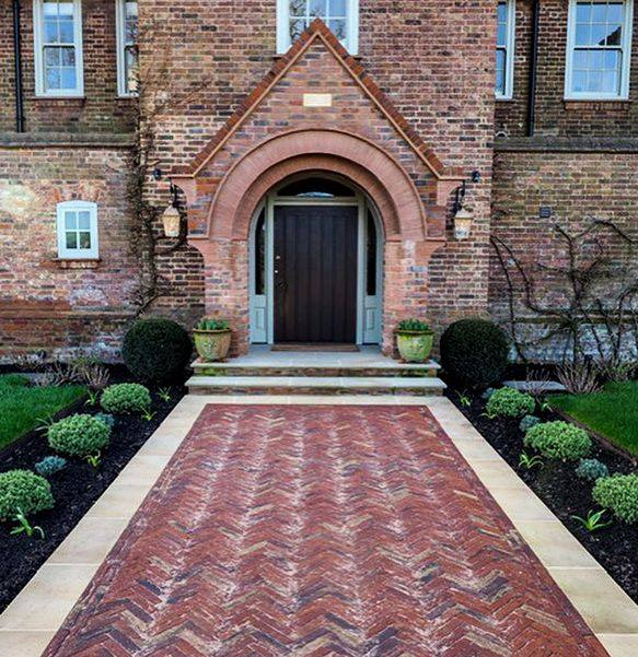 Our Old English clay pavers are used to make a vintage inspired pathway in front of this traditional home.