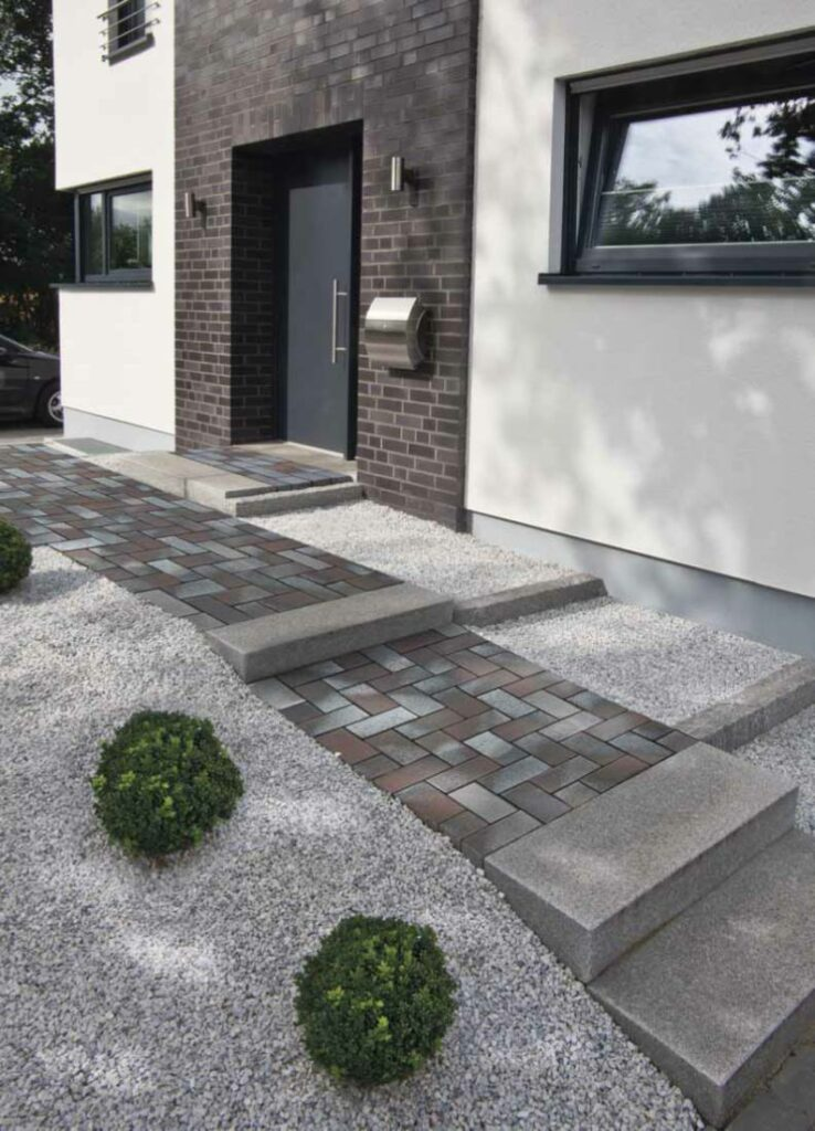 Our Delta Blue Brown clay pavers are used to create a modern style pathway to the entrance on this home.